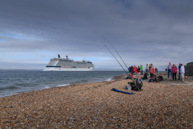 Celebrity Eclipse steaming down Southampton Water past Calshot Castle.