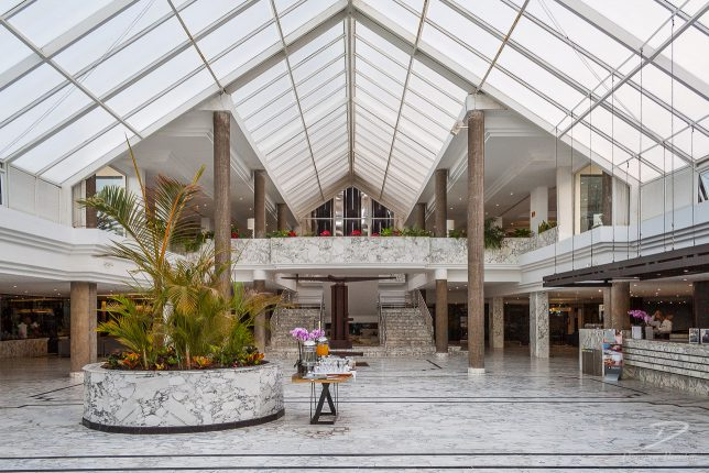 Hotel atrium with white marble floor.