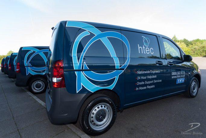 Row of HTEC-branded vans