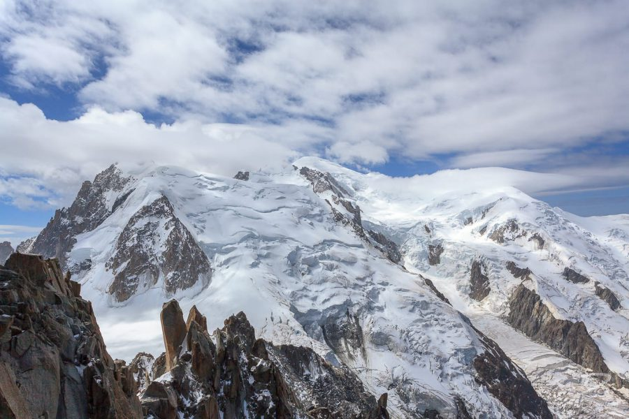 Summit of snow-capped Mont Blanc surrounded by high cloud