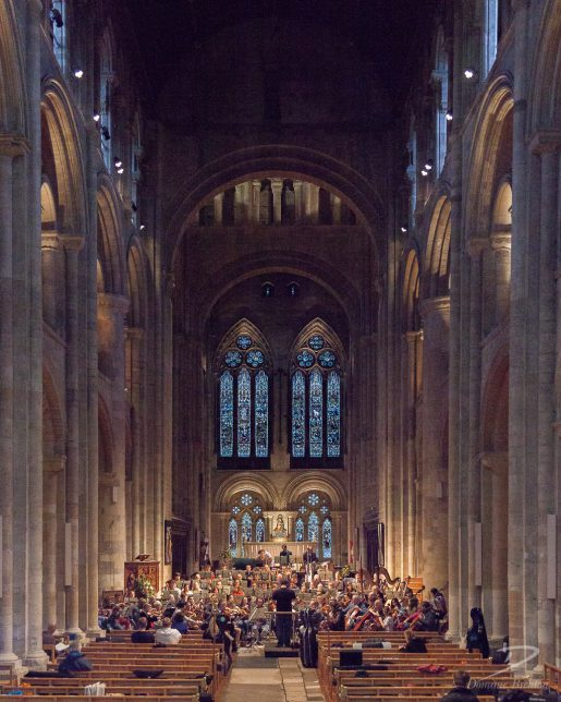 Charity Symphony Orchestra rehearsing in nave of Romsey Abbey