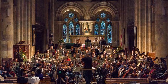 Large orchestra rehearsing in Romsey Abbey