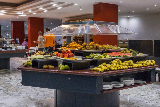 Bananas, melons, kiwis and other fruit on hotel buffet