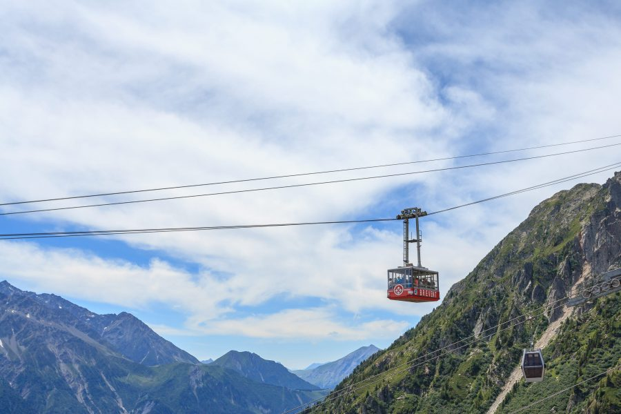 Cable car against mountain backdrop