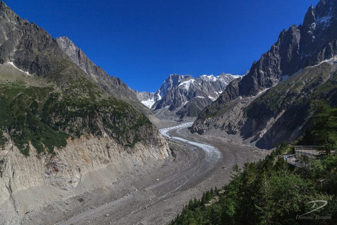 Tail of glacier in steep rocky valley