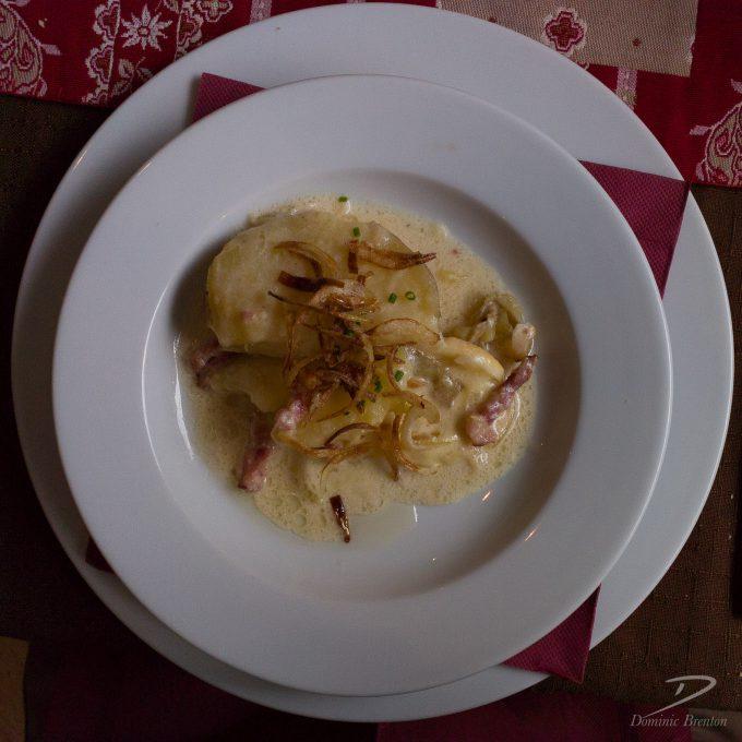 Tartiflette in white bowl